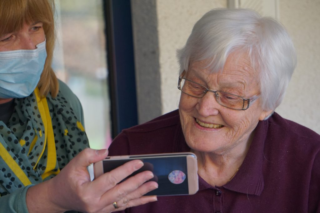Older adult looking at a smart phone